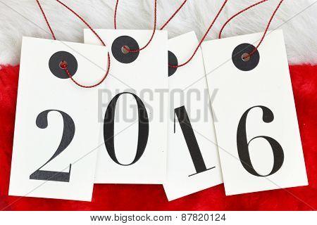 New year 2016 on tags on santas fur