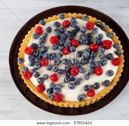 Sweet Cake With Cream Cheese And Fresh Berries.