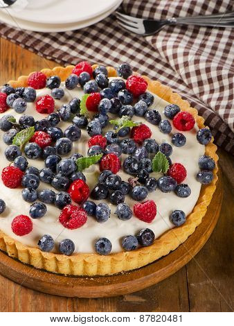 Cheese Cake With  Raspberries And Blueberries.