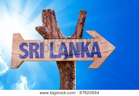 Sri Lanka wooden sign with sky background
