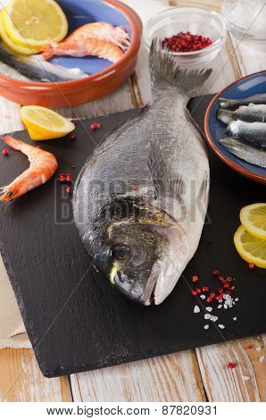 Fresh Raw Fish  With  Spices And Shrimps - Healthy Food.