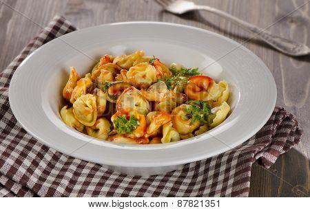 Ravioli Pasta With Tomato Sauce And Herbs.