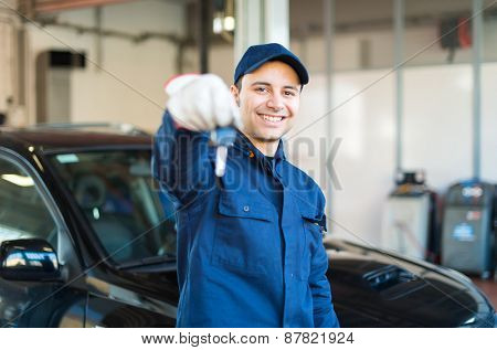 Mechanic giving you the car keys