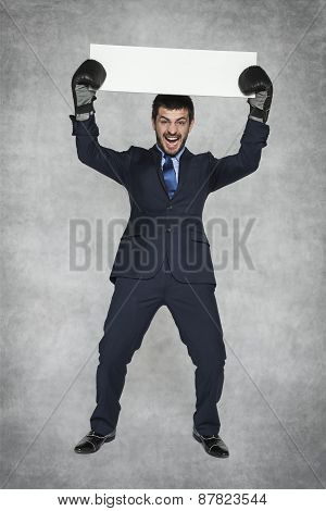 Businessman Performs Victorious Gesture