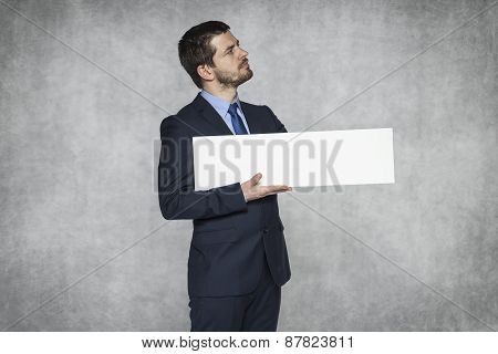Proud Businessman Holding Advertisement