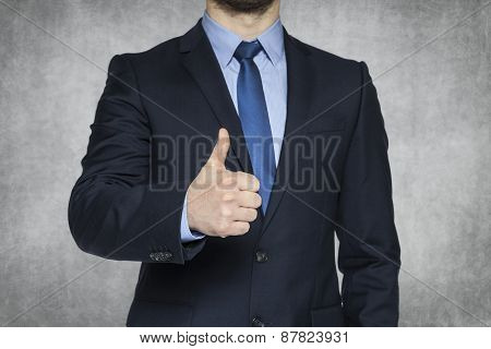 Businessman With Thumb Lifted Upwards