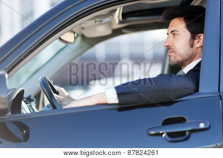 Handsome man driving his car
