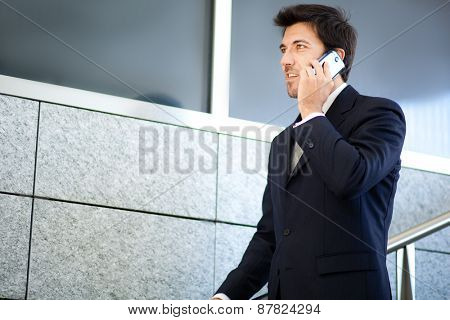 Mature businessman on the phone outdoor