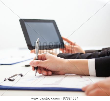 Woman taking notes during a meeting