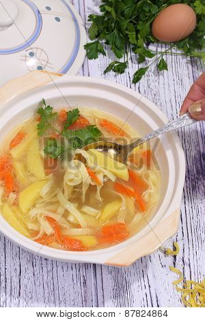 The Female Hand Holds A Spoon With Soup
