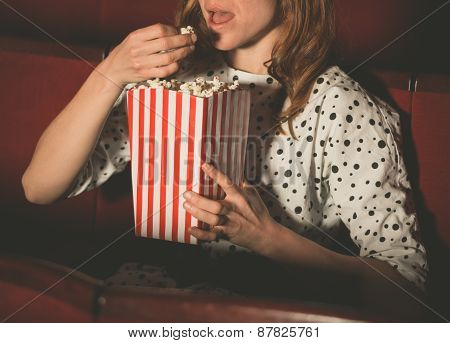 Woman Eating Popcorn And Watching Movie