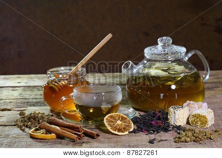Tea In A Transparent Teapot And A Cup And Honey