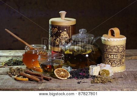 Teapot With Green Tea And Honey In Transparent Bank