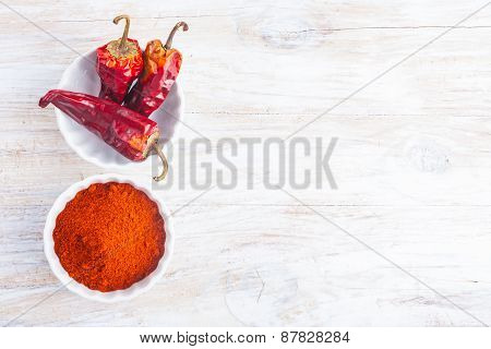 Dry Chilli Pepper On A White Wooden Table