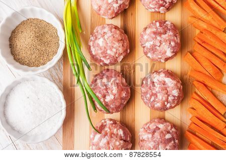 Raw Meatballs With Minced Meat On Kitchen Boardl