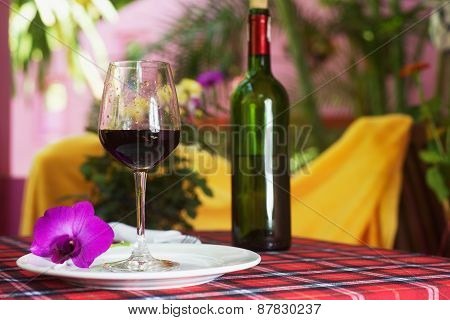 Glass with red wine on the table
