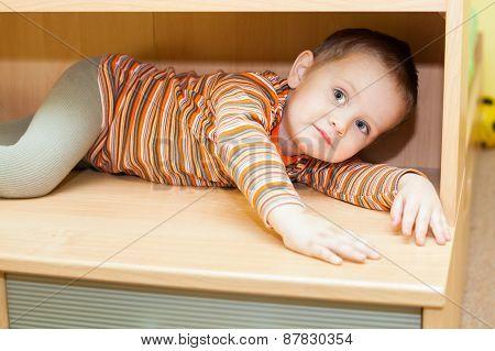 Child Boy Hiding In Cupboard