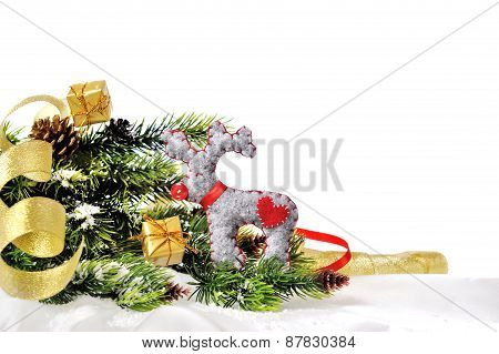 Christmas Deer On The Background Of Christmas Tree With Gifts