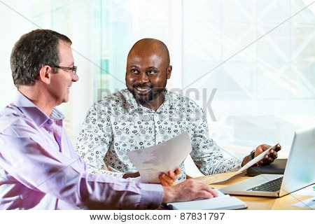Diverse Business Partners At Desk.