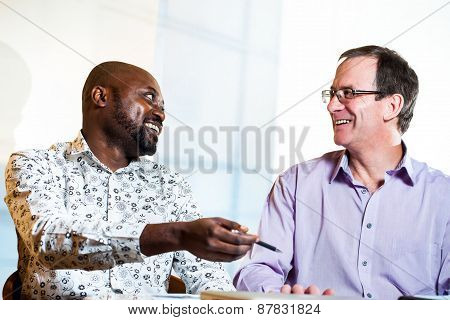 Diverse Business Partners Discussing Work.