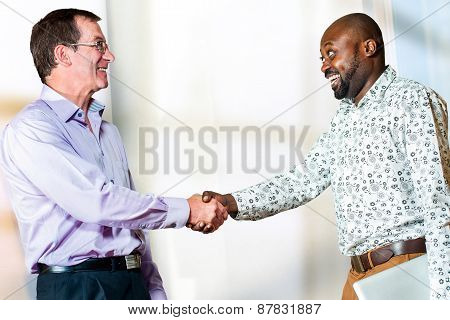 Diverse Business Partners Shaking Hands.