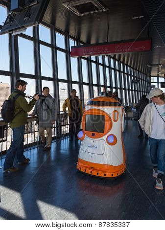 Tourists Interact With The Robot On The Tokyo Tv Tower