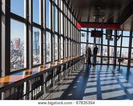 Tourists Look At The City From Tokyo Tv Tower