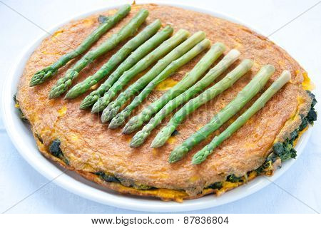 Egg omelet with spinach and asparagus from italy