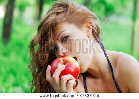 attractive girl eating an apple