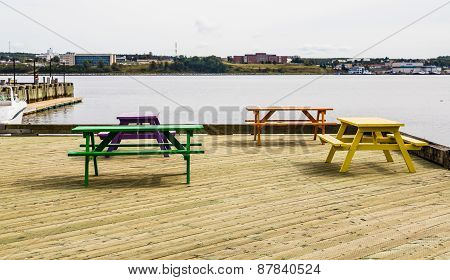 Colorful Picnic Benches On Wood Dock