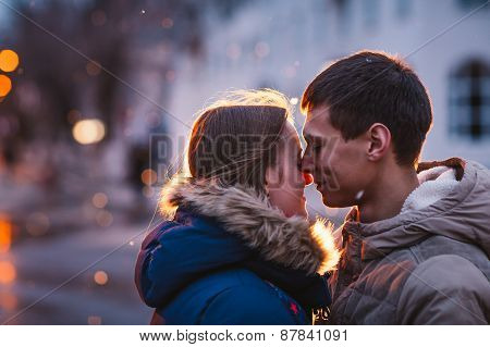 Portrait Of Young Beautiful Couple Kissing In An Autumn Rainy Day.
