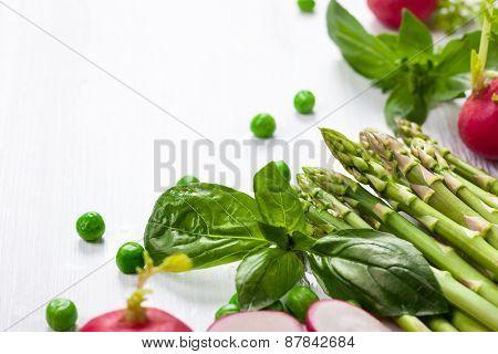 Fresh vegetables on the white wooden table.