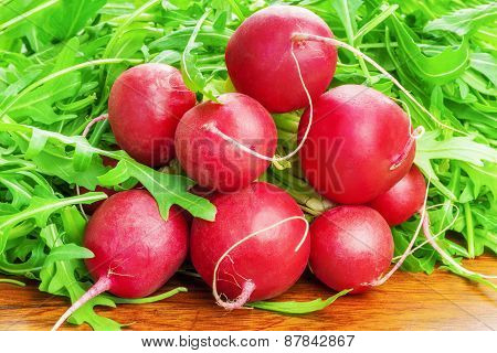 Red radishes with greens around