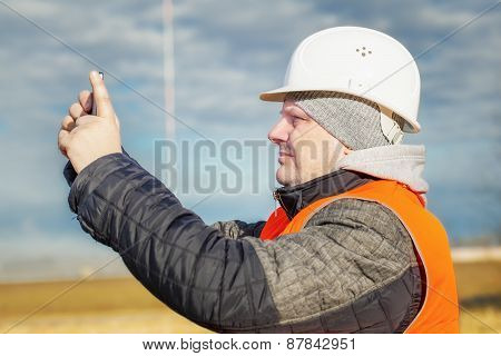 Engineer filmed with tablet PC at outdoors