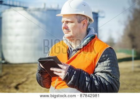 Engineer working with tablet PC in the factory