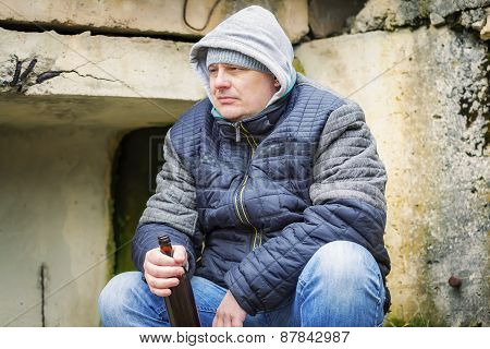Man with beer bottle at outdoors