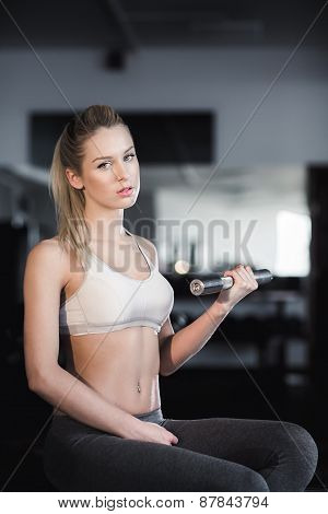Girl Posing With Dumbbells In The Gym