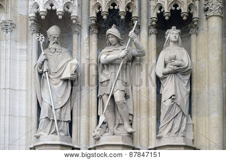 ZAGREB, CROATIA - APRIL 04, 2015: Statue of Saints Methodius, George and Barbara, portal of the cathedral dedicated to the Assumption of Mary and to kings Saint Stephen and Ladislaus