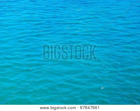 Blue tranquil sea water background.