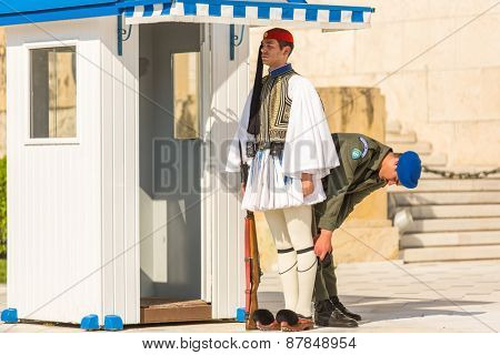 ATHENS, GREECE - APR 13, 2015: Greek soldiers Evzones (or Evzoni) dressed in full dress uniform, refers to the members of the Presidential Guard, an elite ceremonial unit, active from 1833 - present.