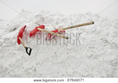 Shovels in the snow.