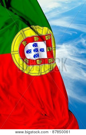 Portuguese waving flag on a beautiful day