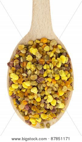 Bee Pollen In Wooden Spoon Isolated On The White Background