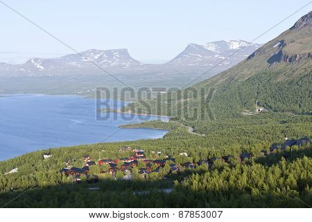 Nordic mountains in early June, building in a village.