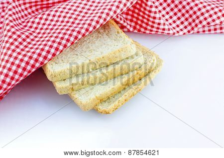 Sliced Wholewheat Bread And Napkin On White Background With Place For Your Text