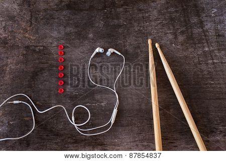 Drumsticks and earphones