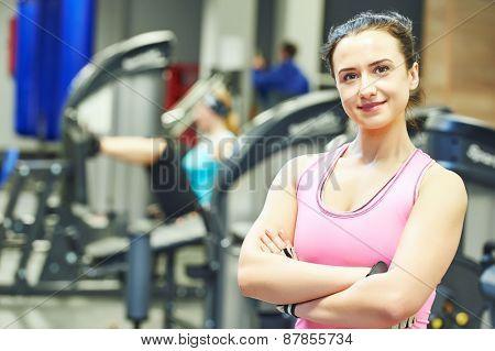 woman instructor portrait in sport club gym