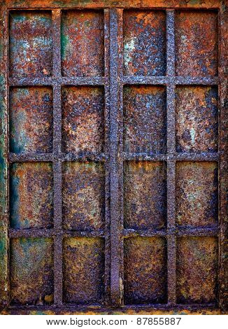Background of grungy window with rusty iron bars and shutter plate