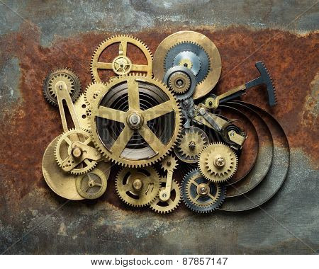 Metal collage of clockwork on rusty background