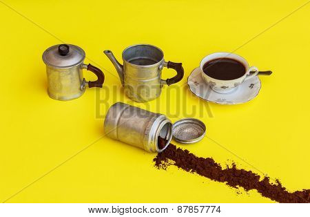 The Components  Of A Coffee Maker With Alongside the Cup Full Of Coffee Ready To Drink